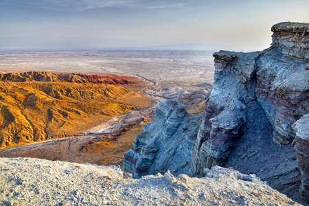 Aerial view of bizarre layered mountains in desert park Altyn Emel in Kazakhstan Stock fotó