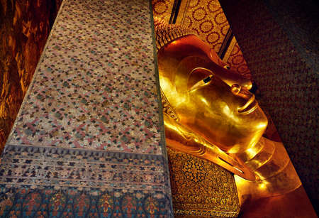Famous Statue of Big Golden Buddha in wat Pho temple in Bangkok, Thailand. Symbol of Buddhist culture.