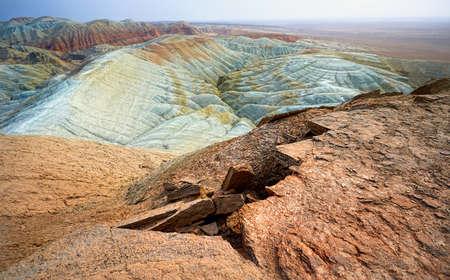 Bizarre layered mountains in desert park Altyn Emel in Kazakhstan. Geological specific of desert landscape.
