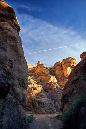 Orange rocks and road at Charyn canyon at sunset in Kazakhsthan