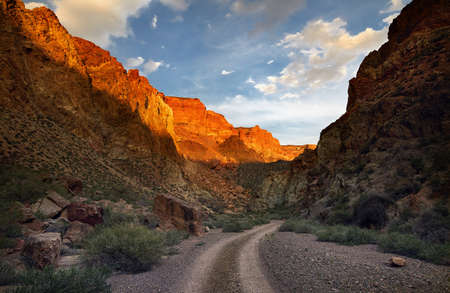 Orange rocks and road at Charyn canyon at sunset in Kazakhsthan
