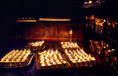 Buddhist lamp for peace in Bodnath temple in Kathmandu the capital of Nepal