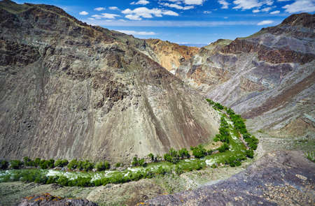 Aerial shot of river Charyn in canyon at mountain background in Kazakhsthan Stock Photo