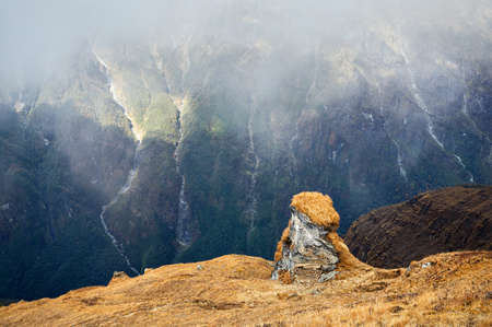 Landscape of Rocks and Waterfalls at foggy day in Himalaya Mountains in Nepal Stock Photo