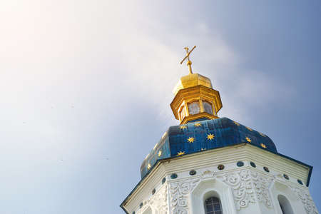 Blue dome with stars and golden cross of Kiev Pechersk Lavra. Old historical architecture in Kiev, Ukraine