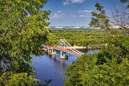 Aerial view to walking bridge crossing Dnepr river in Kiev, Ukraine