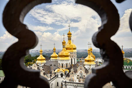 Church with golden domes at Kiev Pechersk Lavra Christian complex.