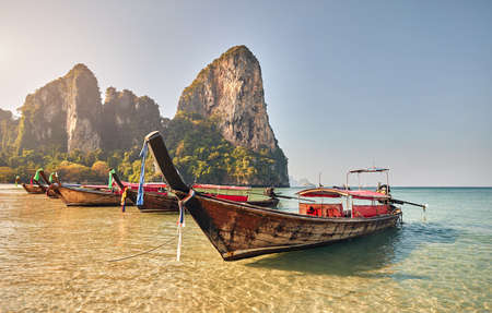 Long tail boats on tropical island at Krabi province, Thailand 스톡 콘텐츠