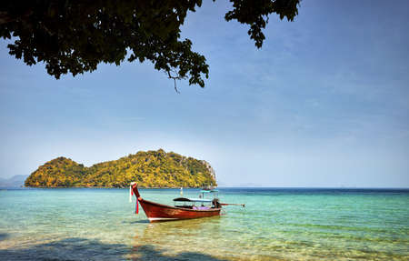 Longtail boat near tropical islands at sunny day in Andaman Sea, Thailand