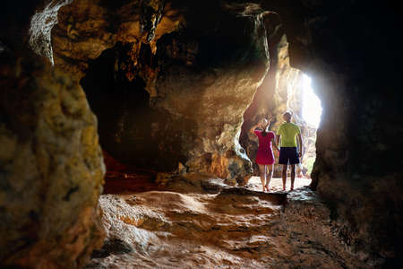 Happy young couple in the big cave at Phra Nang beach, Krabi province in Southern Thailand.