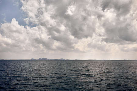 Tropical islands Phang Nga in Andaman sea of Krabi province at overcast cloudy sky in Thailand