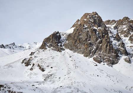 High rocky mountain with snow at Zaili Alatay range in Almaty, Kazakhstan