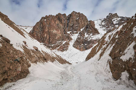 High rocky mountain with snow at Zaili Alatay range in Almaty, Kazakhstan