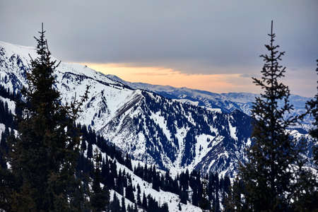 High snowy mountains at sunset in Almaty, Kazakhstan