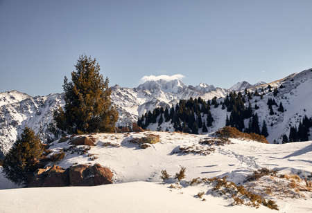High mountains with snow and peak Talgar in Northern Tien Shan, Kazakhstan Stock Photo