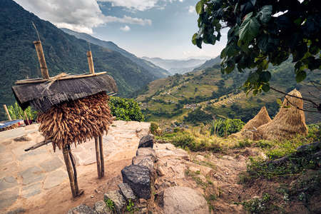 Beautiful scenic of village with corn storage and rice field in mountain valley in Himalayas, Nepal