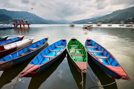 Color boats at Phewa lake shore in Pokhara, Nepal.