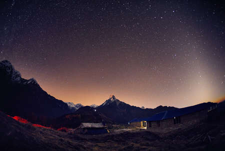 Machapuchare Mountain of Himalayas at night starry sky in Nepal