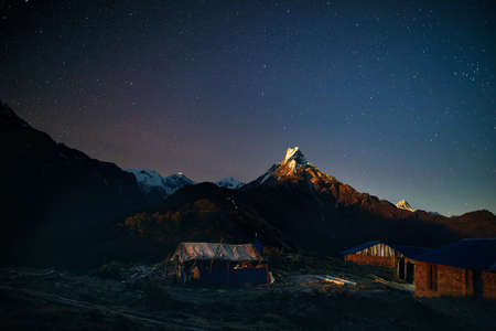 Village in the Himalayas Mountains at night starry sky in Nepal Stock Photo