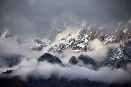 Beautiful landscape of Himalaya Mountain surrounded by clouds in Nepal Stock Photo