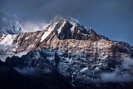 Beautiful landscape of Himalaya Mountain Annapurna surrounded by clouds in Nepal Stock Photo