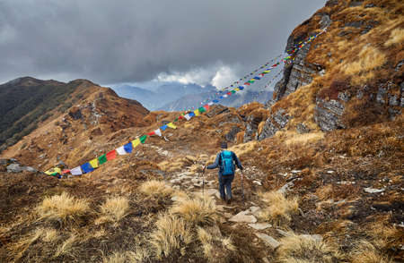 Man with backpack on the trail at the Mardi Himal Treck of Himalaya Mountains in Nepal