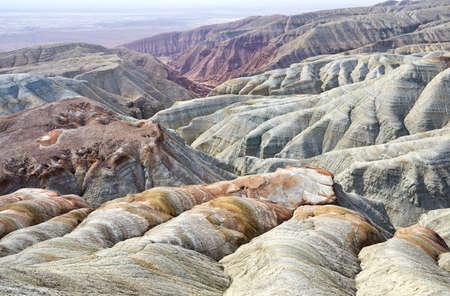 Bizarre layered mountains in desert park Altyn Emel in Kazakhstan Stock Photo