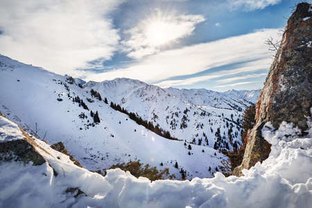 High mountains with snow and high peaks at winter time Stock Photo