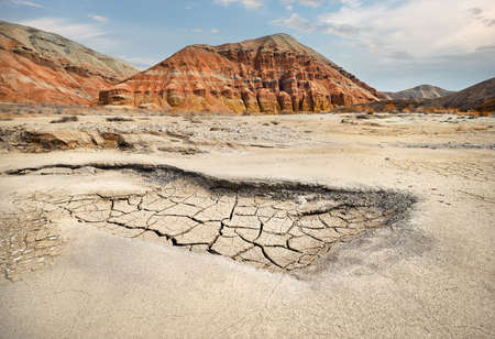 Red Mountains and cracked dry earth in the desert of Kazakhstan