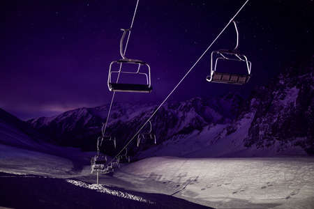 Cable car station at the mountain with starry night sky in Shymbulak ski resort in Almaty, Kazakhstan Stock Photo