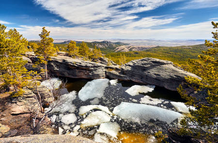 Beautiful Lake with ice in the rocky mountains with pine woods of Karkaraly national park in Central Kazakhstan Reklamní fotografie
