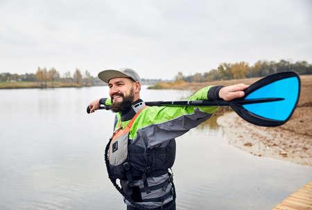 Portrait of bearded man in wetsuit on the beach