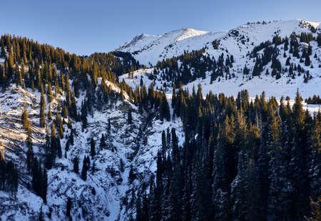 High snowy mountain Kumbel at Zaili Alatay range in Almaty, Kazakhstan