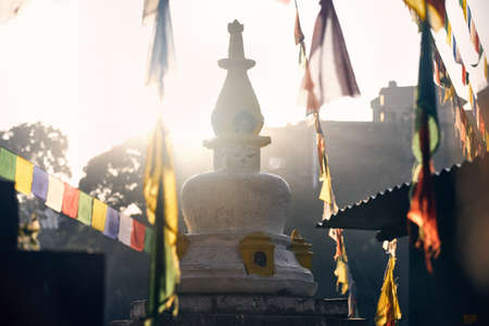 Stupa with Buddha eyes and prayer flags at Swayambhunath monastery in Kathmandu, Nepal