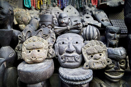 Tradition Nepalese masks carved from stone in the shop of Thamel district, Kathmandu valley, Nepal