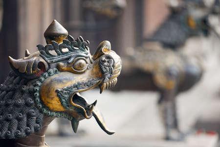 Old statue of dragon in Buddhist temple of Kathmandu, Nepal
