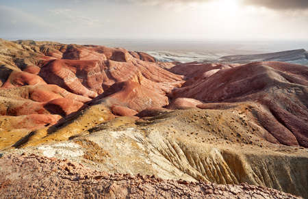Red mountains and Canyons at sunset in desert park Altyn Emel in Kazakhstan