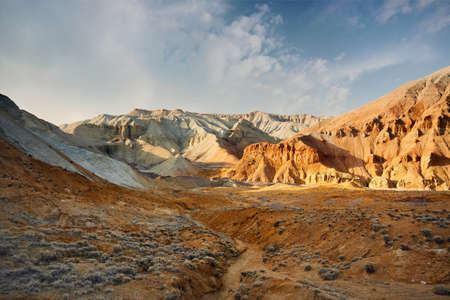 Canyon with layered mountains in the desert park Altyn Emel in Kazakhstan