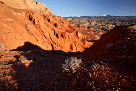 Landscape of Red mountains in the desert canyon against blue sky in Kazakhstan