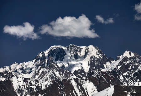 High mountains with snow and peak Talgar in Northern Tien Shan, Kazakhstan Stock fotó