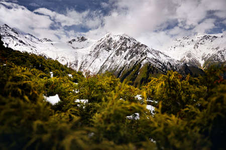 Landscape of snow mountain valley against cloudy sky in Kazakhstan Stok Fotoğraf