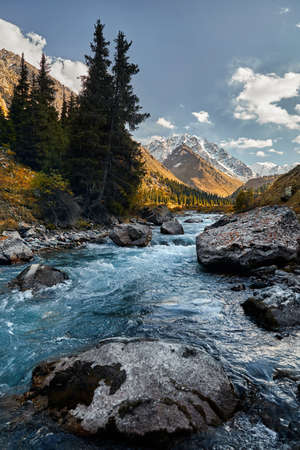 Beautiful landscape of river in the mountain valley and autumn yellow forest in Kazakhstan, Almaty Stock fotó