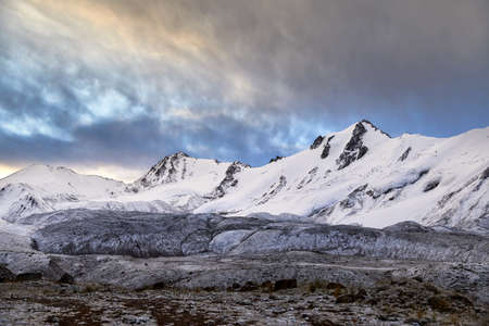 Beautiful scenery of snowy mountains at vibrant sunrise sky in Southern Kazakhstan