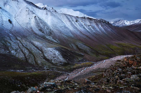 Beautiful scenery of snowy mountains and river in the Tien Shan valley of South Kazakhstan