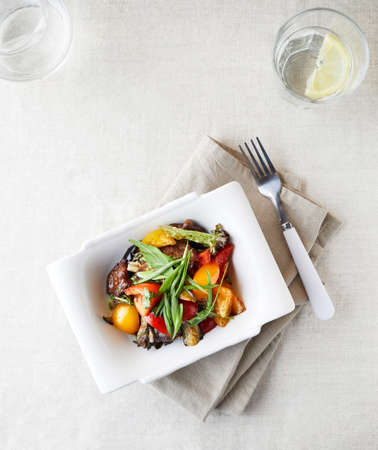 Vegetarian salad with fresh greenery, capsicum, tomato and fried eggplants top view Reklamní fotografie