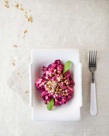 Salad with beetroot and walnuts on the table in restaurant