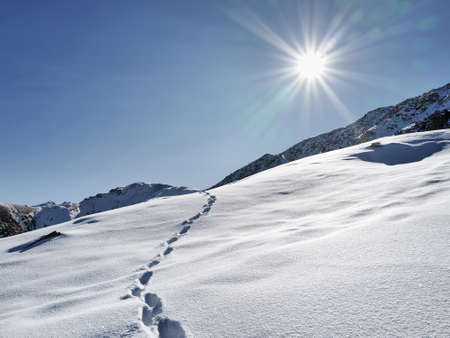 Beautiful Minimalism landscape at high mountains with snow against blue sky at winter time in Kazakhstan
