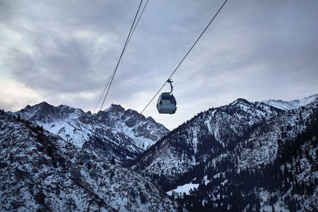 Cableway with funicular in the winter mountains at Shymbulak mountain resort in Almaty, Kazakhstan