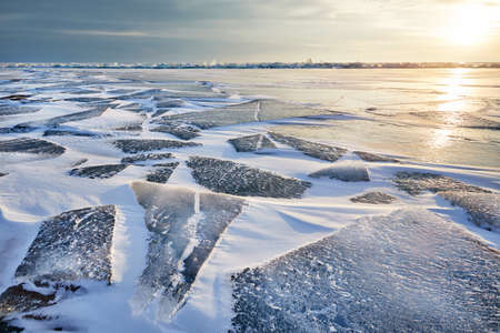 Beautiful landscape of Ice hummock and cracks at frozen lake Baikal, Russia