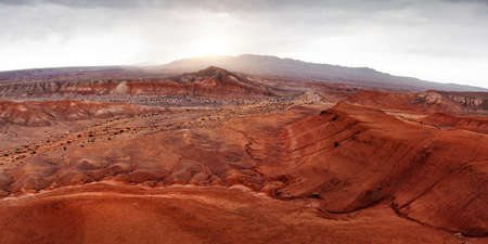 Aerial panorama of Red mountains Boguty in the desert canyon against sunset sky in Kazakhstan Zdjęcie Seryjne